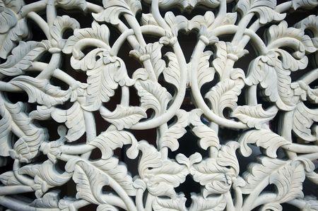 Cement carving of rose leaf motif.