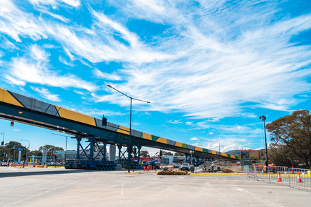 Adelaide, Australia - September 8, 2018: Ayliffes Road, Darlington's largest bridge progress. 195 metre long structure is still supported by self-propelled modular transporters