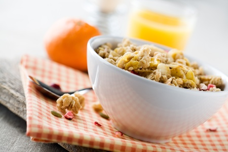Breakfast with fresh muesli and orange juice