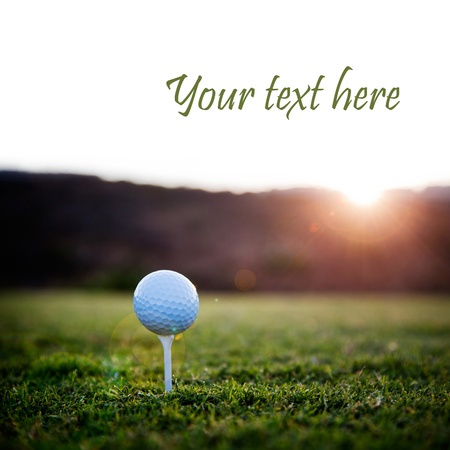 Golf ball on white tee, selective focus
