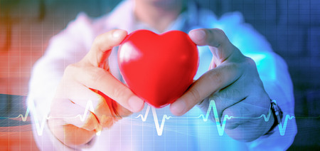 Photo pour abstract background of hands holding heart model with symbol of heart pulse signal - image libre de droit