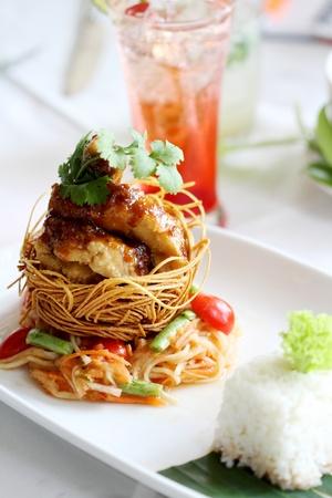 A disk of Thai food