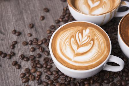 Foto de latte or Cappuccino with frothy foam, coffee cup top view on table in cafe. - Imagen libre de derechos