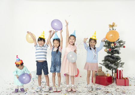 Foto de Group of kids celebrate christmas and happy new year party together. - Imagen libre de derechos