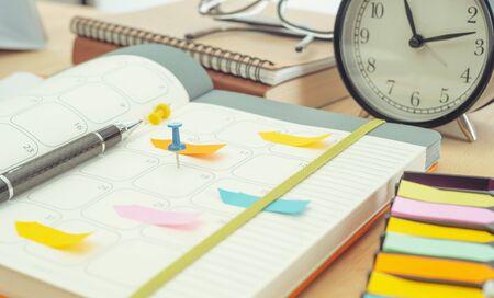 Photo pour Schedule diary notebook on table. management remind meeting concept - image libre de droit