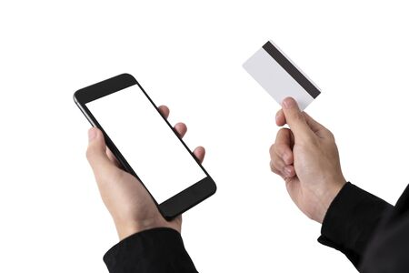 Photo pour Hand Holding Credit Card and Mobile Phone Blank Screen for Mockup Template Advertising and Mobile Banking Technology Background. - image libre de droit