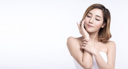 Foto de Beauty Young asian woman with perfect facial skin. Gestures for advertisement treatment spa and cosmetology. - Imagen libre de derechos