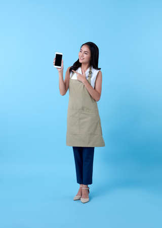 Photo for Entrepreneur asian woman using smartphone on blue background. - Royalty Free Image