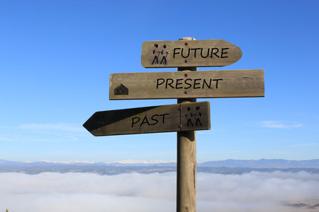 Foto de three signs indicating the way to future, present and past - Imagen libre de derechos