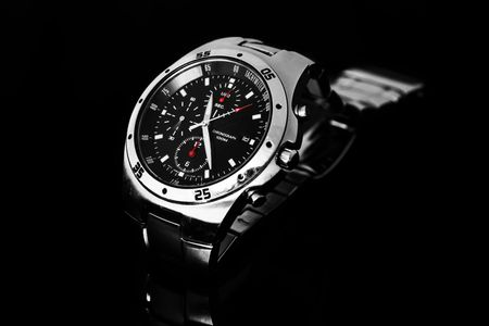 Men's wrist watch isolated against black