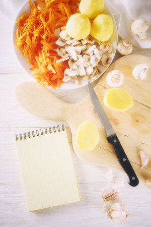 ingredients for soup and notepad