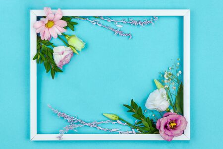 Photo for Composition of pink and white flowers are lined inside frame on blue background. Greeting card template, invitation for celebration, party - Royalty Free Image