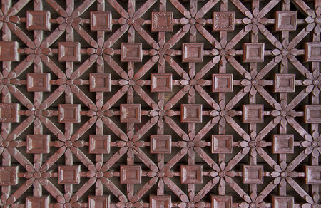 delicate carved wooden window lattice