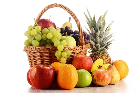 Wicker basket with fruits isolated on white