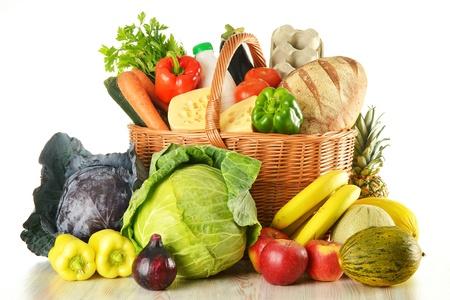 Foto für Groceries in wicker basket isolated on white - Lizenzfreies Bild