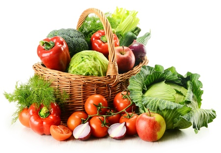 Foto de Composition with raw vegetables and wicker basket isolated on white - Imagen libre de derechos