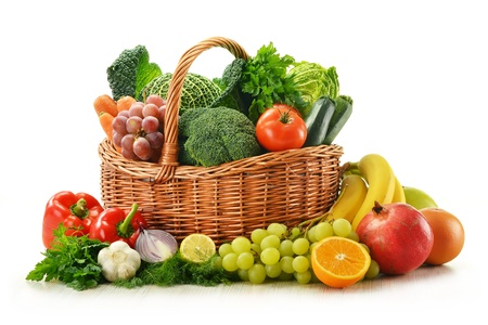 Composition with vegetables and fruits in wicker basket isolated on whiteの写真素材