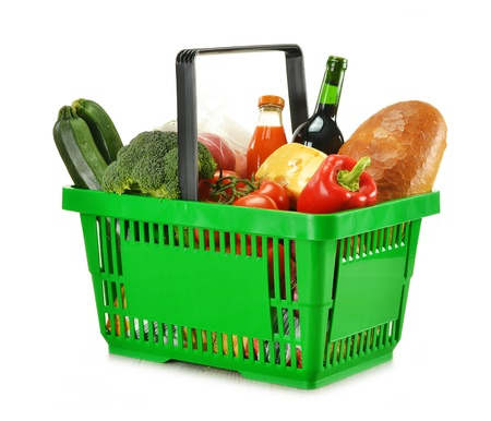 Composition with shopping basket and groceries isolated on white