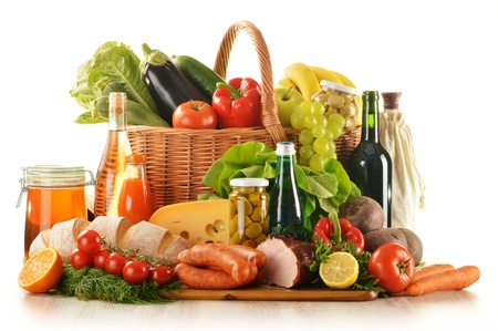 Composition with variety of grocery products including vegetable, fruits, meat, dairy and wineの写真素材