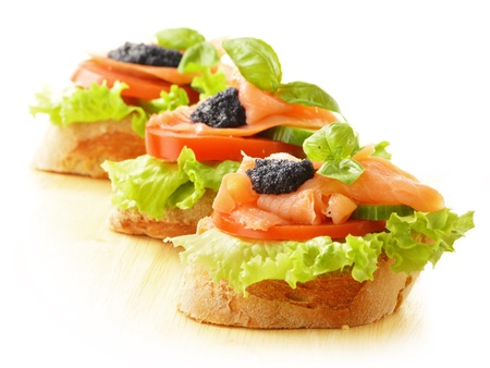 Three sandwiches with salmon and caviar  Fish snack