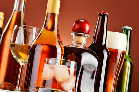 Photo for Bottles and glasses of assorted alcoholic beverages. - Royalty Free Image