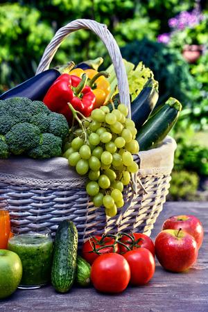 Foto für Variety of fresh organic vegetables and fruits in the garden. Balanced diet - Lizenzfreies Bild