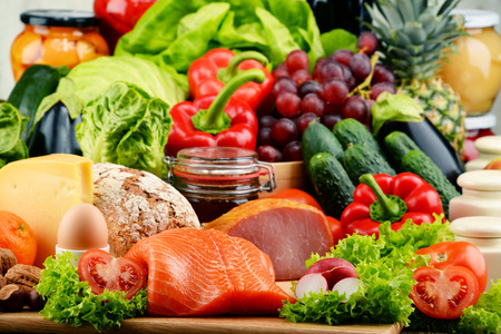Photo pour Variety of organic food including vegetables fruit bread dairy and meat. Balanced diet. - image libre de droit