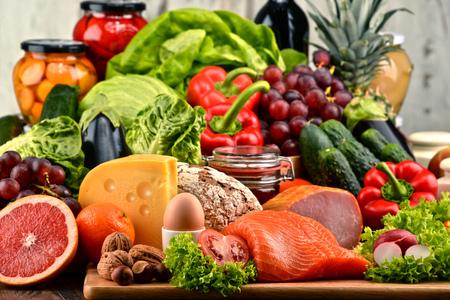 Foto de Variety of organic food including vegetables fruit bread dairy and meat. Balanced diet. - Imagen libre de derechos