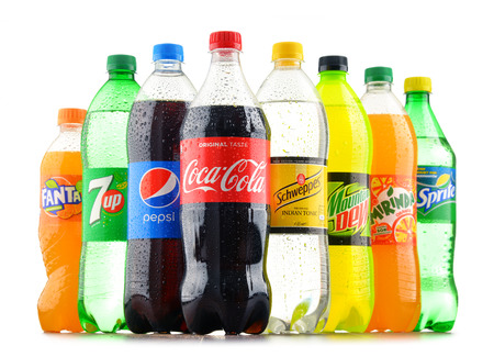 Foto de POZNAN, POLAND - JAN 18, 2017: Global soft drink market is dominated by brands of few multinational companies founded in North America. Among them are Pepsico, Coca Cola and Dr. Pepper Snapple Group - Imagen libre de derechos
