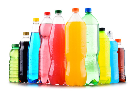 Photo pour Plastic bottles of assorted carbonated soft drinks over white background - image libre de droit