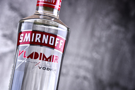 POZNAN, POLAND - MAR 30, 2018: Bottle of Smirnoff, a brand of vodka produced by the British company Diageo. Founded in Moscow by Pyotr Arsenievich Smirnov it is now distributed in 130 countries