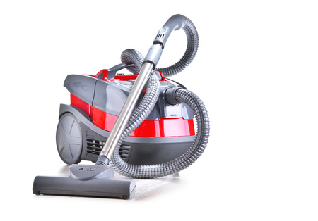 Canister vacuum cleaner for home use isolated on white.