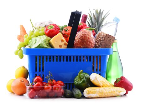 Photo for Plastic shopping basket with assorted grocery products isolated on white - Royalty Free Image
