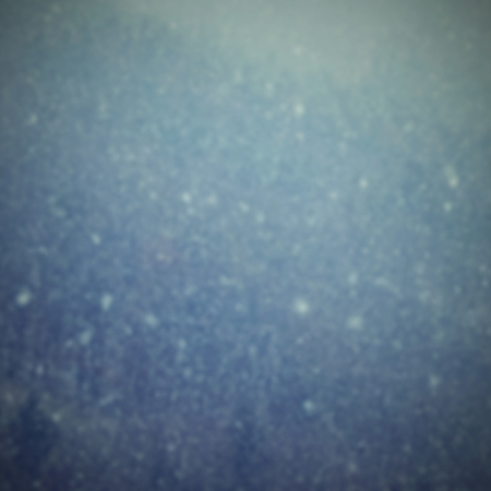 Snowfall. Beautiful winter background seasonal nature and the weather in winter. Winter landscape with falling snow.