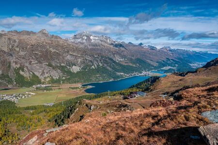view of Lake Silvaplana and St. Moritz from Furtschellas in Engadin in Autumn