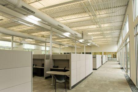 Photo pour A collection of work stations inside an office space - image libre de droit