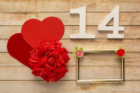 Photo pour Wooden background with flowers, hearts, frame and wooden numbers of dated 14 February. The concept of Valentine Day. - image libre de droit