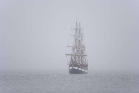 Tall ship in the morning mist