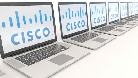 Modern laptops with Cisco Systems logo. Computer technology conceptual editorial 3D