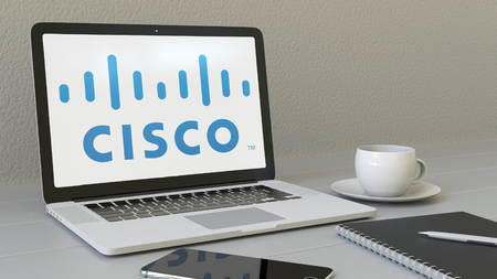 Laptop with Cisco Systems logo on the screen. Modern workplace conceptual editorial 4K animation