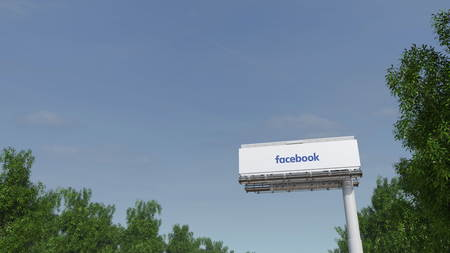 Driving towards advertising billboard with Facebook inscription 3D