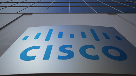 Outdoor signage board with Cisco Systems logo. Modern office building. Editorial 3D rendering