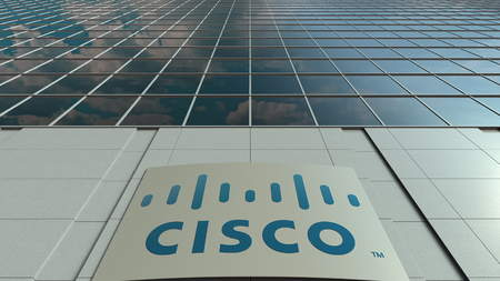 Signage board with Cisco Systems logo. Modern office building facade. Editorial 3D rendering