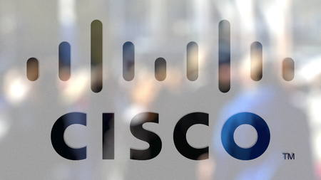 Cisco Systems logo on a glass against blurred crowd on the steet. Editorial 3D rendering