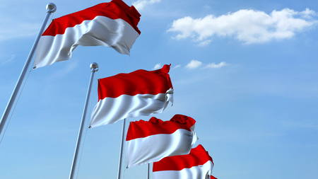 Photo pour Waving flags of Indonesia against the sky. 3D rendering - image libre de droit