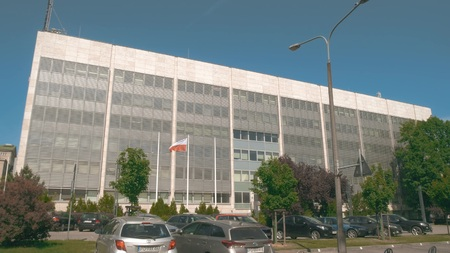POZNAN, POLAND - MAY 20, 2018. Office building and waving Polish flag