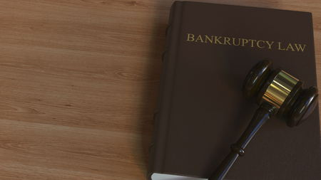 Judge gavel on BANKRUPTCY LAW book. Conceptual 3D rendering