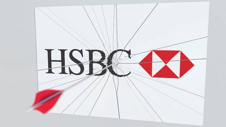 HSBC company logo being cracked by archery arrow. Corporate problems conceptual editorial 3D rendering