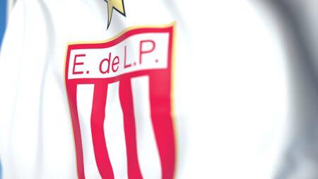 Flying flag with Estudiantes de Laplata football club logo, close-up. Editorial 3D rendering