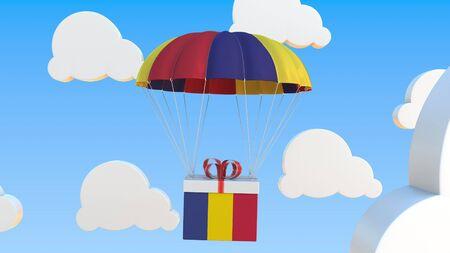 Photo pour Box with national flag with a parachute. Conceptual 3D - image libre de droit